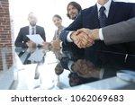 handshake business partners at... | Shutterstock . vector #1062069683