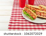 hot dogs on wooden background | Shutterstock . vector #1062072029