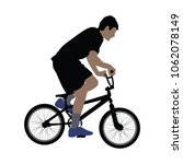 a male bicyclist riding a... | Shutterstock .eps vector #1062078149