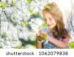 happy little girl playing in... | Shutterstock . vector #1062079838