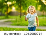 little girl playing with... | Shutterstock . vector #1062080714