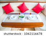 luxury lunch table setting on a ...   Shutterstock . vector #1062116678