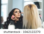 makeup and hairstyle for a... | Shutterstock . vector #1062122270