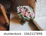 bouquet of flowers and greens... | Shutterstock . vector #1062127898