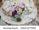 bouquet of flowers and greens... | Shutterstock . vector #1062127904