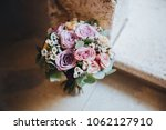 bouquet of flowers and greens... | Shutterstock . vector #1062127910