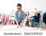 three women at garment factory. ... | Shutterstock . vector #1062139910