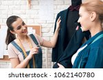 two women at garment factory... | Shutterstock . vector #1062140780