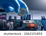 the technician is laying a cpu... | Shutterstock . vector #1062151853