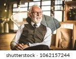 portrait of senior businessman... | Shutterstock . vector #1062157244