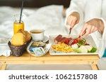breakfast in bed  cozy hotel... | Shutterstock . vector #1062157808