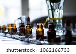 perfume bottles in a row | Shutterstock . vector #1062166733