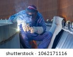 male  worker wearing protective ... | Shutterstock . vector #1062171116