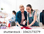 three girls at garment factory. ... | Shutterstock . vector #1062173279
