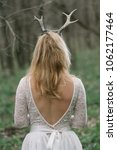 long haired woman with antlers... | Shutterstock . vector #1062177464