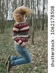 happy woman in forest | Shutterstock . vector #1062178508