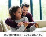 happy couple with pregnancy news | Shutterstock . vector #1062181460