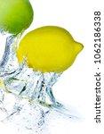 lime and lemon splashing water... | Shutterstock . vector #1062186338