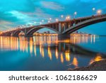 the illuminated bridge over the ... | Shutterstock . vector #1062186629