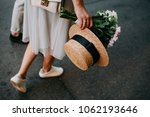 girl with straw hat and flowers ... | Shutterstock . vector #1062193646