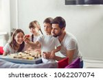 happy family playing board...   Shutterstock . vector #1062207074