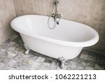 bathtub decoration in bathroom... | Shutterstock . vector #1062221213