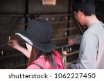 Stock photo people turning on candles in a shinto temple 1062227450