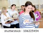 woman with an e book reader... | Shutterstock . vector #106225454