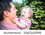 father holding his laughing one ...   Shutterstock . vector #1062263090