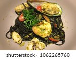 black spaghetti with seafood...   Shutterstock . vector #1062265760