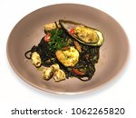 black spaghetti with seafood...   Shutterstock . vector #1062265820