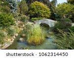 stone bridge over a creek in a... | Shutterstock . vector #1062314450