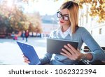 young businesswoman sitting in... | Shutterstock . vector #1062322394