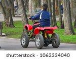 a boy on a mechanical atv... | Shutterstock . vector #1062334040