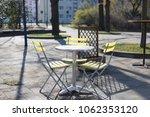 yellow bistro chairs or garden... | Shutterstock . vector #1062353120