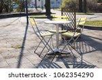 yellow bistro chairs or garden... | Shutterstock . vector #1062354290