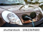 detail of plugged in mini van... | Shutterstock . vector #1062369683