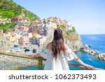 tourist looking at scenic view... | Shutterstock . vector #1062373493