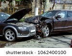 frontal collision of two cars. | Shutterstock . vector #1062400100
