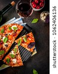 pizza and red wine on dark... | Shutterstock . vector #1062406136