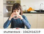 cute little girl drinking water ... | Shutterstock . vector #1062416219