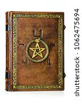 Small photo of Vintage leather book with gilded ouroboros, pentagram and embossed five elements symbols on the ancient Egyptian.