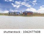 modern house near water | Shutterstock . vector #1062477608