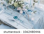 elegant table setup in blue... | Shutterstock . vector #1062480446