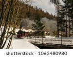 a historic steam locomotive is... | Shutterstock . vector #1062480980