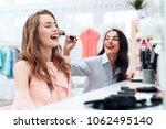 girls do makeup in the showroom.... | Shutterstock . vector #1062495140