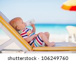 Portrait Of Baby On Sunbed...