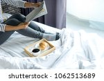 relax woman read a book on the... | Shutterstock . vector #1062513689