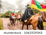 gauchos riding and carrying the ... | Shutterstock . vector #1062529343