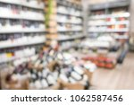blurred wine and whisky on... | Shutterstock . vector #1062587456